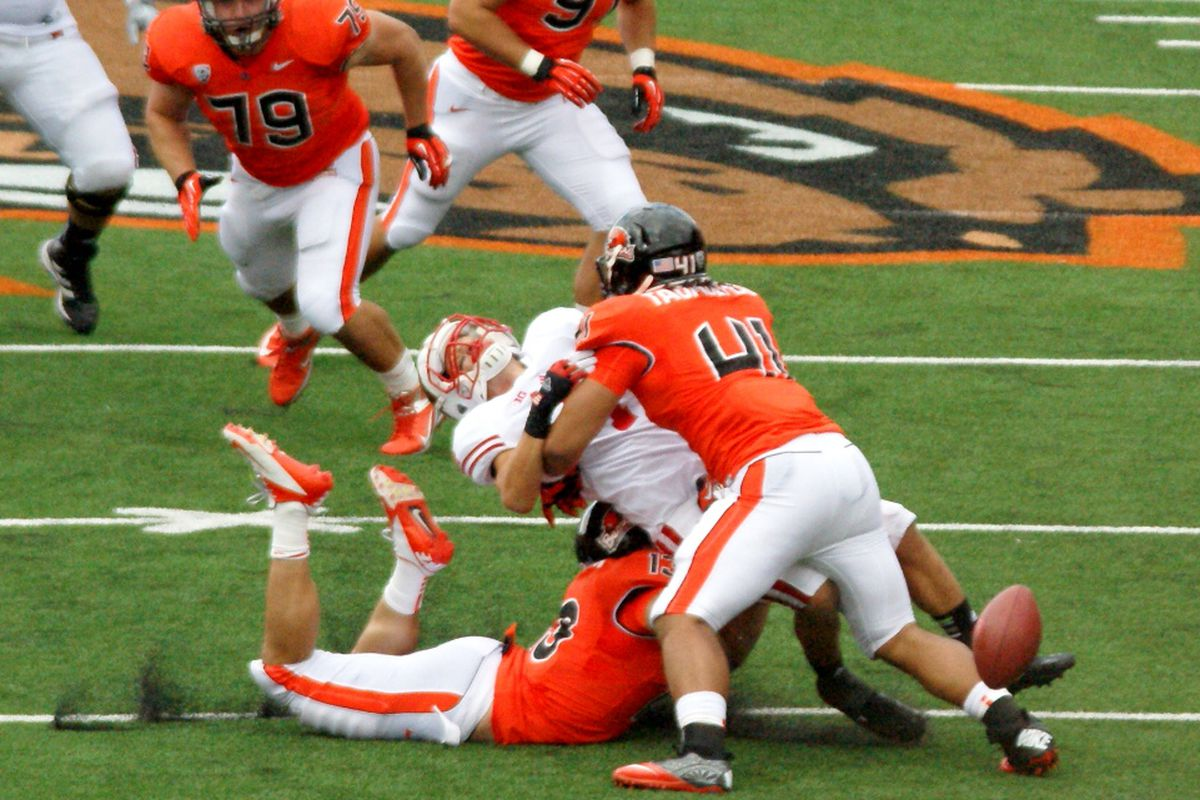Oregon St.'s Feti Taumoepeau puts a stop to Wisconsin's Jared Abbrederis' crossing routes. <em>(Photo by Andy Wooldridge)</em>