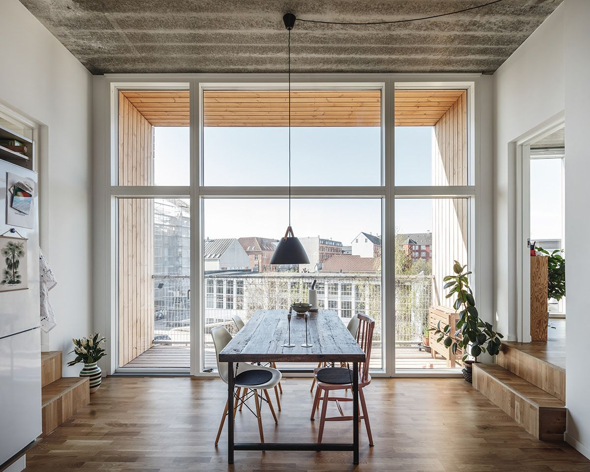Dining room with big windows and table