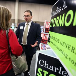 Charles Stormont, Democratic candidate for Utah attorney general, talks to Heidi Matthews at the Utah Education Association Convention and Education Exposition at the South Towne Expo Center in Sandy on Thursday, Oct. 16, 2014.
