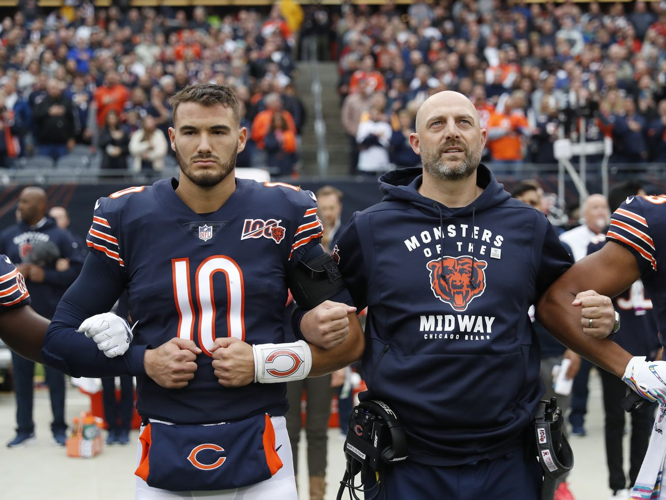 Bears quarterback Mitch Trubisky and coach Matt Nagy link arms during the national anthem before the Saints game.