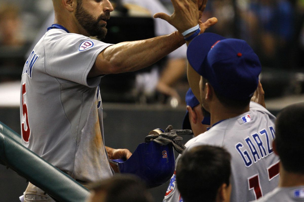 Outfielder Reed Johnson of the Chicago Cubs is congratulated by teammate Matt Garza after scoring a run against the Houston Astros at Minute Maid Park in Houston, Texas. (Photo by Eric Christian Smith/Getty Images)