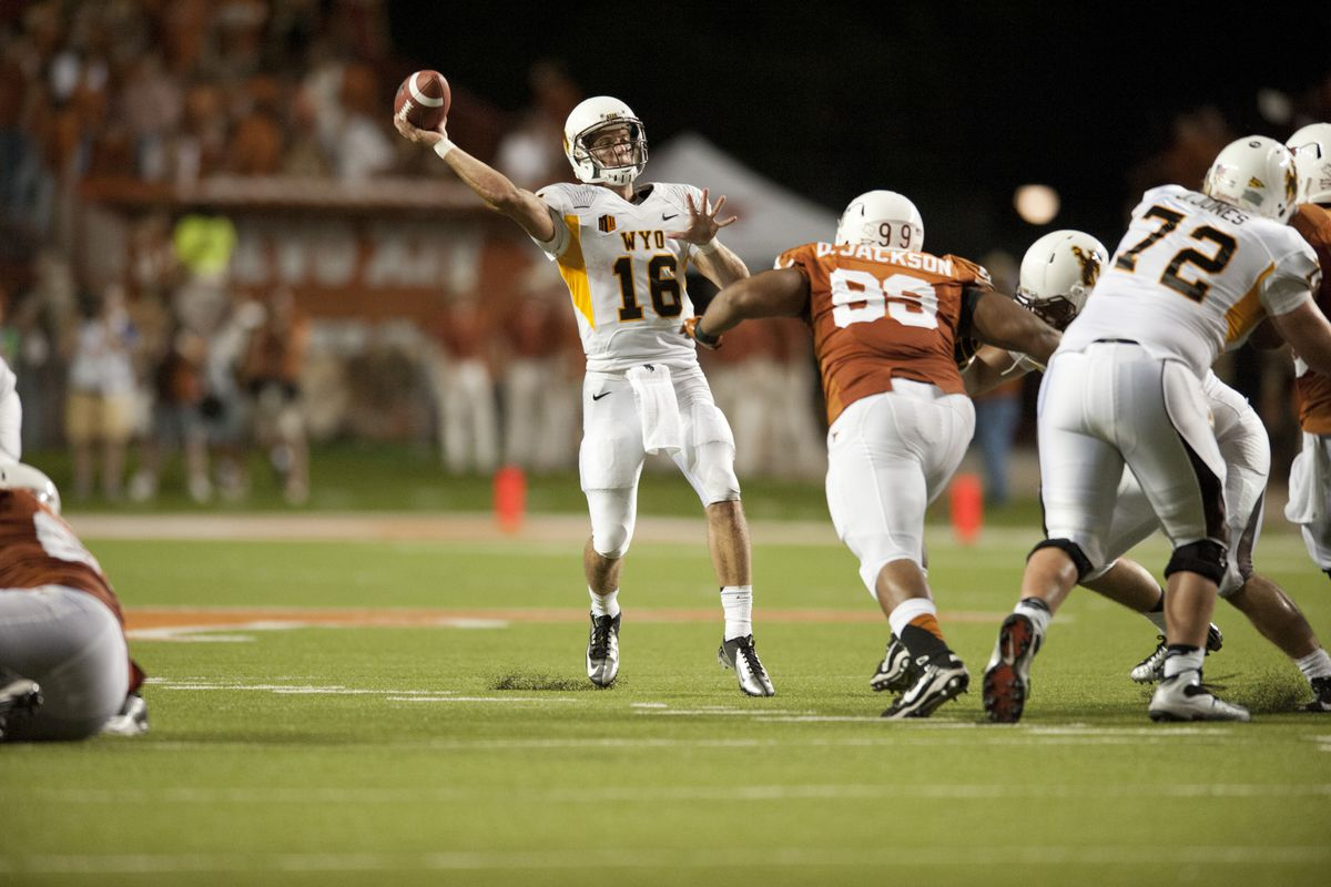 AUSTIN, TX - SEPTEMBER 1: Brett Smith #16 of the Wyoming Cowboys throws a pass against the Texas Longhorns on September 1, 2012 at Darrell K Royal-Texas Memorial Stadium in Austin, Texas.  (Photo by Cooper Neill/Getty Images)