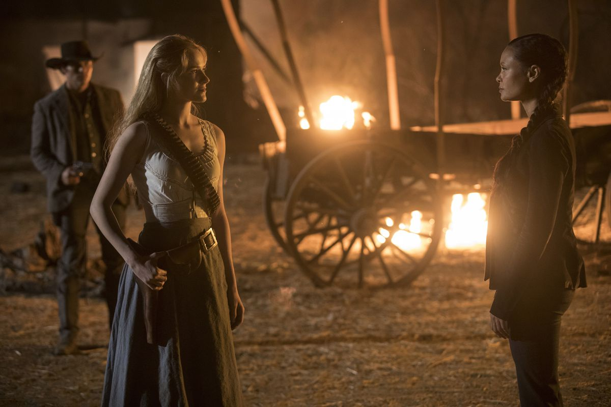 Westworld 202 - Dolores and Maeve talk with Teddy and a burning wagon in the background