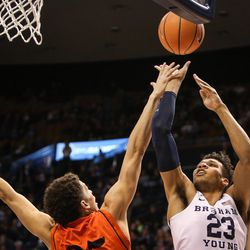 Brigham Young Cougars forward Yoeli Childs (23) takes a shot over Idaho State Bengals forward Kyle Ingram (35) as BYU takes on Idaho State at the Marriott Center in Provo on Thursday, Dec. 21, 2017.