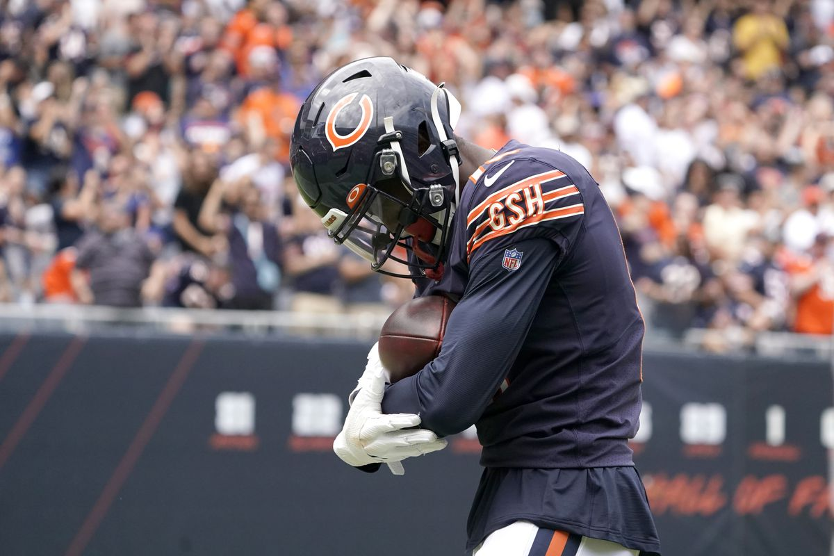 Rodney Adams rocks the football like a baby after his touchdown catch Saturday.