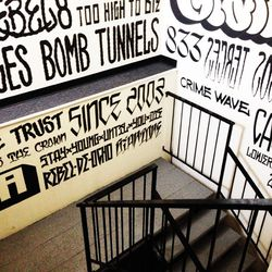 A stairwell leading to the REBEL8 offices is emblazoned with Mike Giant's original hand illustrations.
