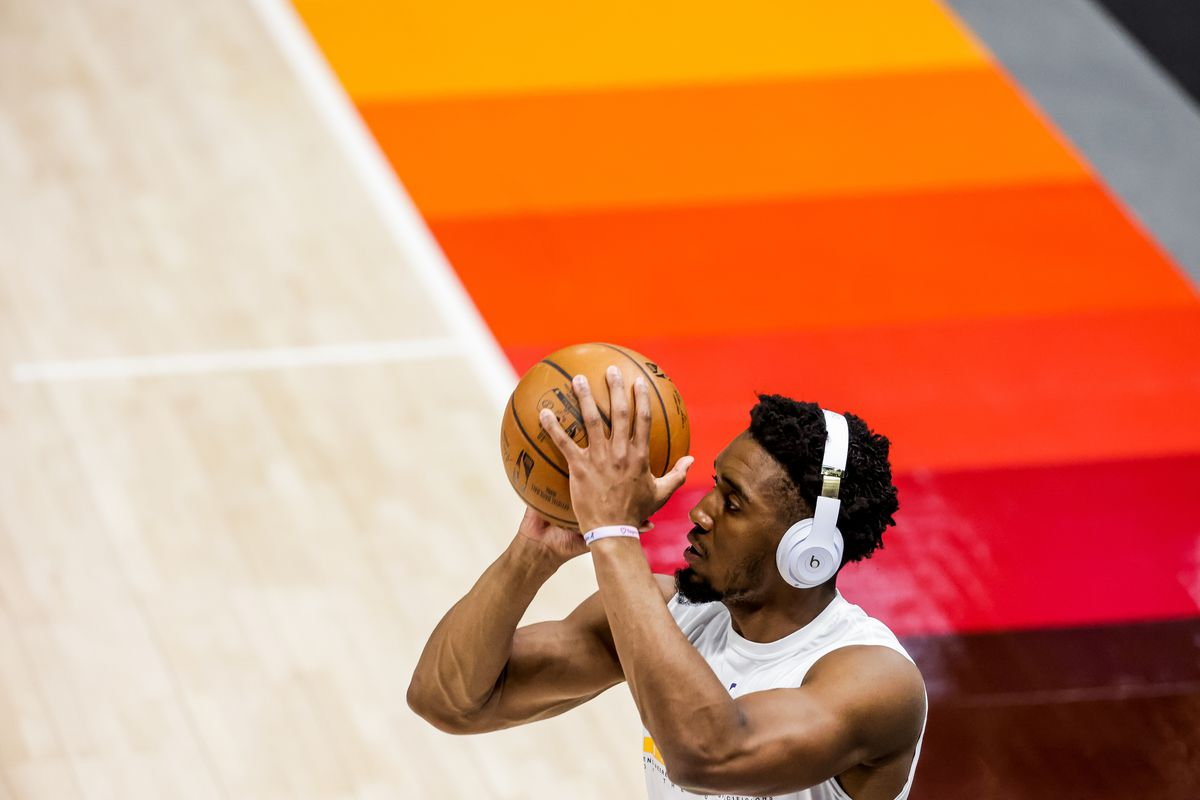 Utah Jazz guard Donovan Mitchell, who will not play in Game 1 of the NBA playoffs against the Memphis Grizzlies, warms up at Vivint Smart Home Arena in Salt Lake City.