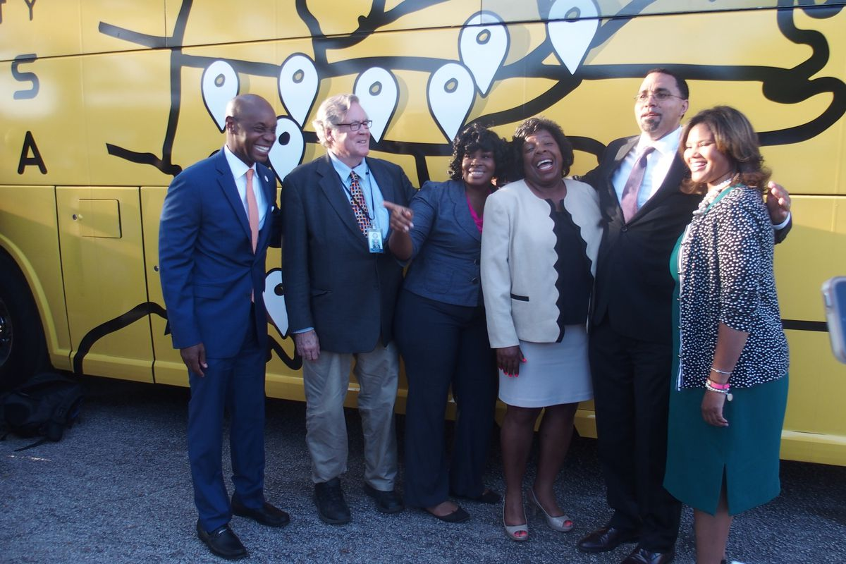 Several Shelby County school board members join with Superintendent Dorsey Hopson (far left) during a 2016 visit from then-U.S. Secretary of Education John King (second from right).