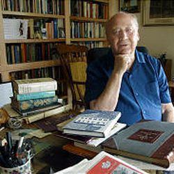Leslie Norris, with some of his works in front of him, sits in his study at his Orem home. Although retired, BYU has named Norris its poet in residence.