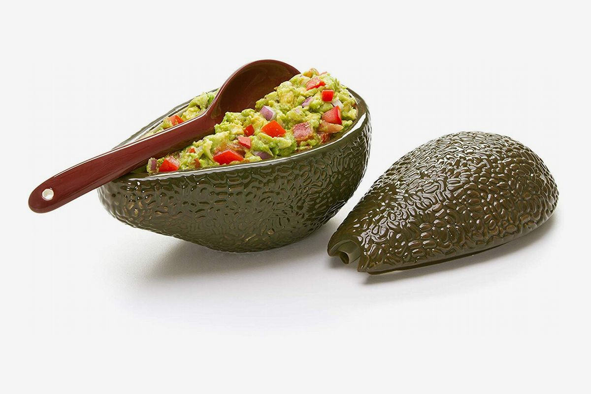 A plastic avocado filled with guacamole