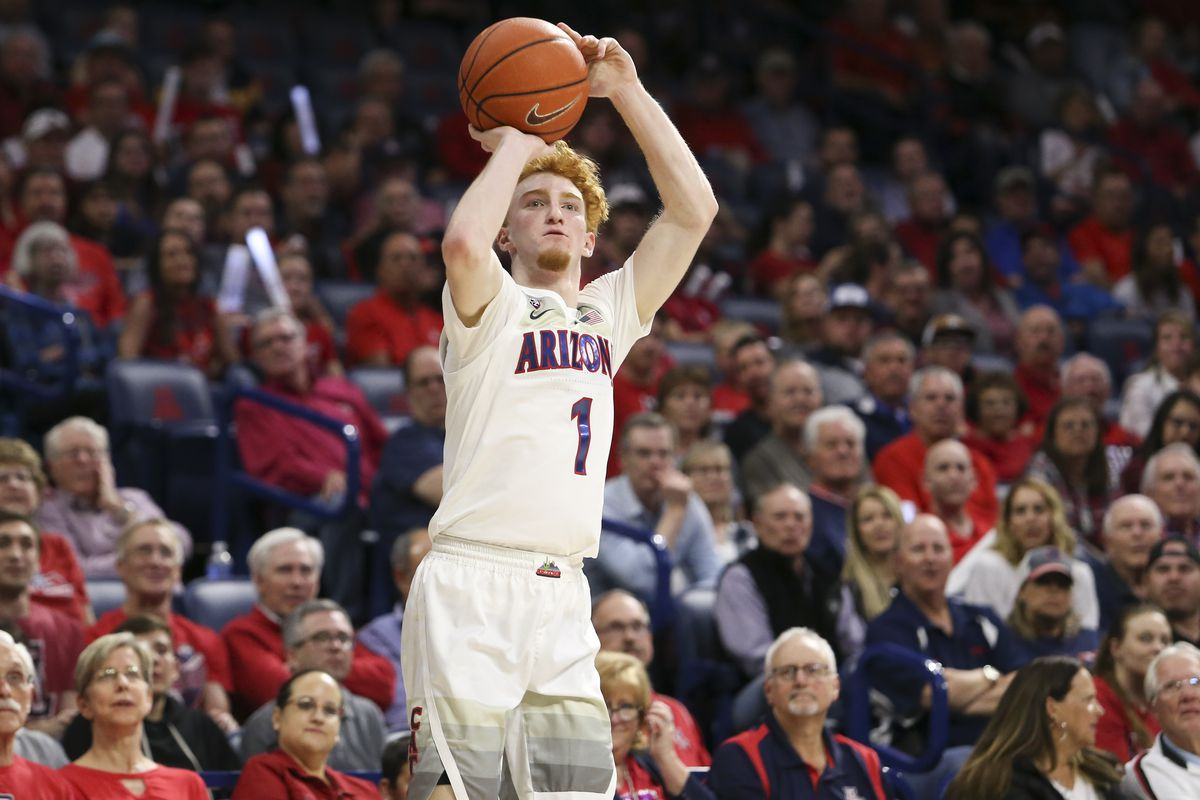 Arizona Wildcats guard Nico Mannion shoots a three point shot against Washington State Cougars in the second half at McKale Center.