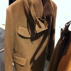The wool military coat . We like.
