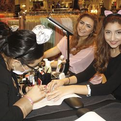 Shoppers getting their nails done.