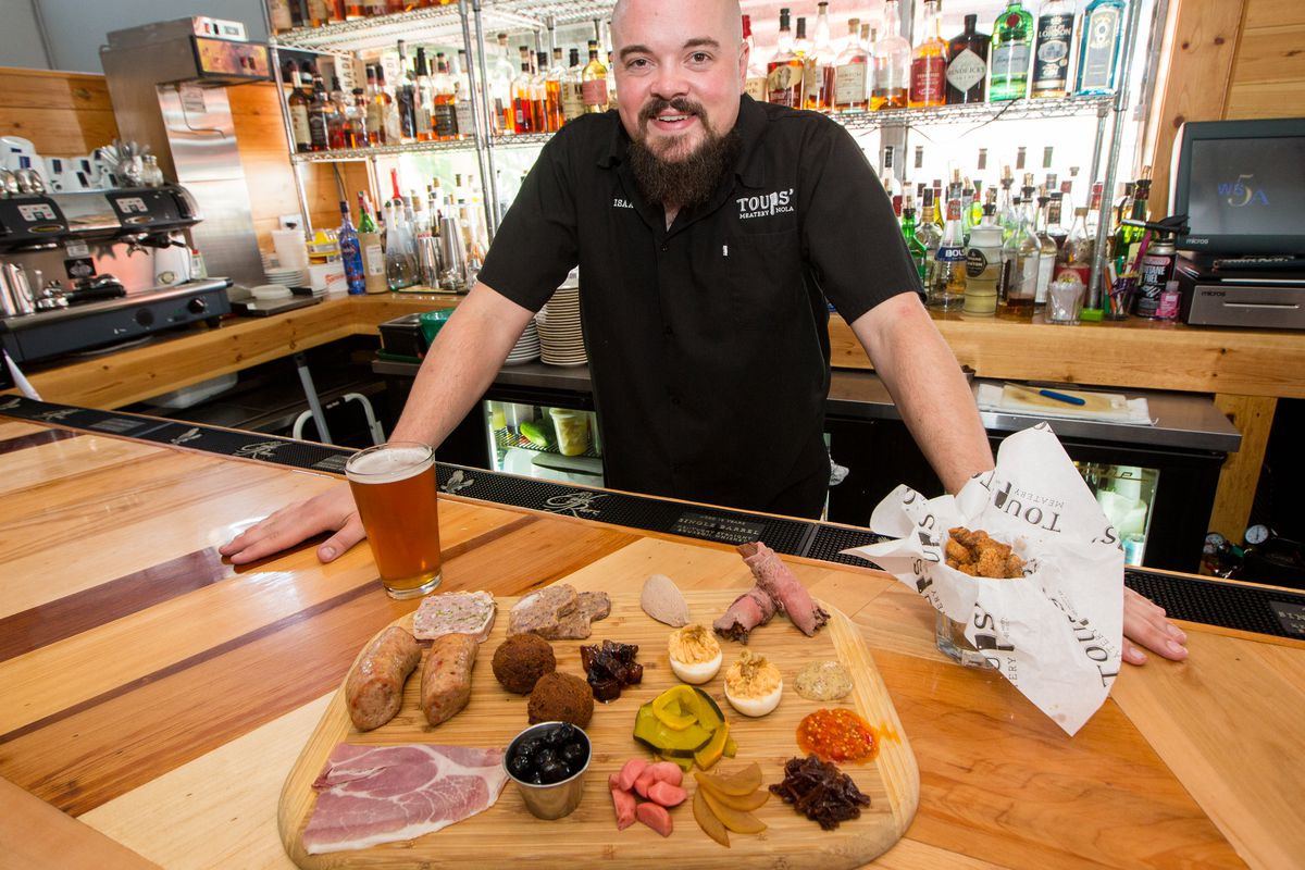 Chef Isaac Toups and his epic meatery board.