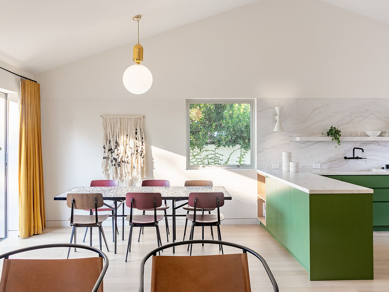 Architect Couple?s L.A. Courtyard House Comes With a Scalloped, Round Kitchen Island and Le Corbusier Lighting