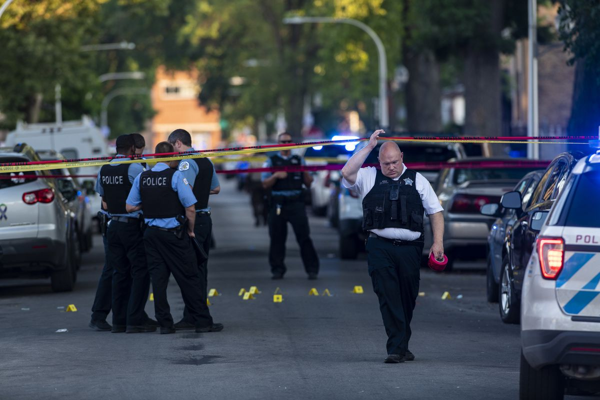 Chicago police officers last Fourth of July weekend in the 100 block of North Latrobe Avenue in Austin, investigating the shootings of two people, including a 7-year-old girl.
