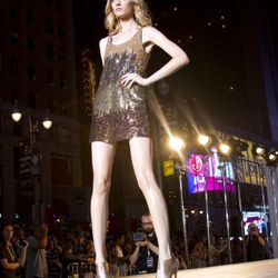 <em>Image via Express</em><br /><br />At 9pm the formal Express Holiday 2011 collection was presented on the same runway in Times Square.