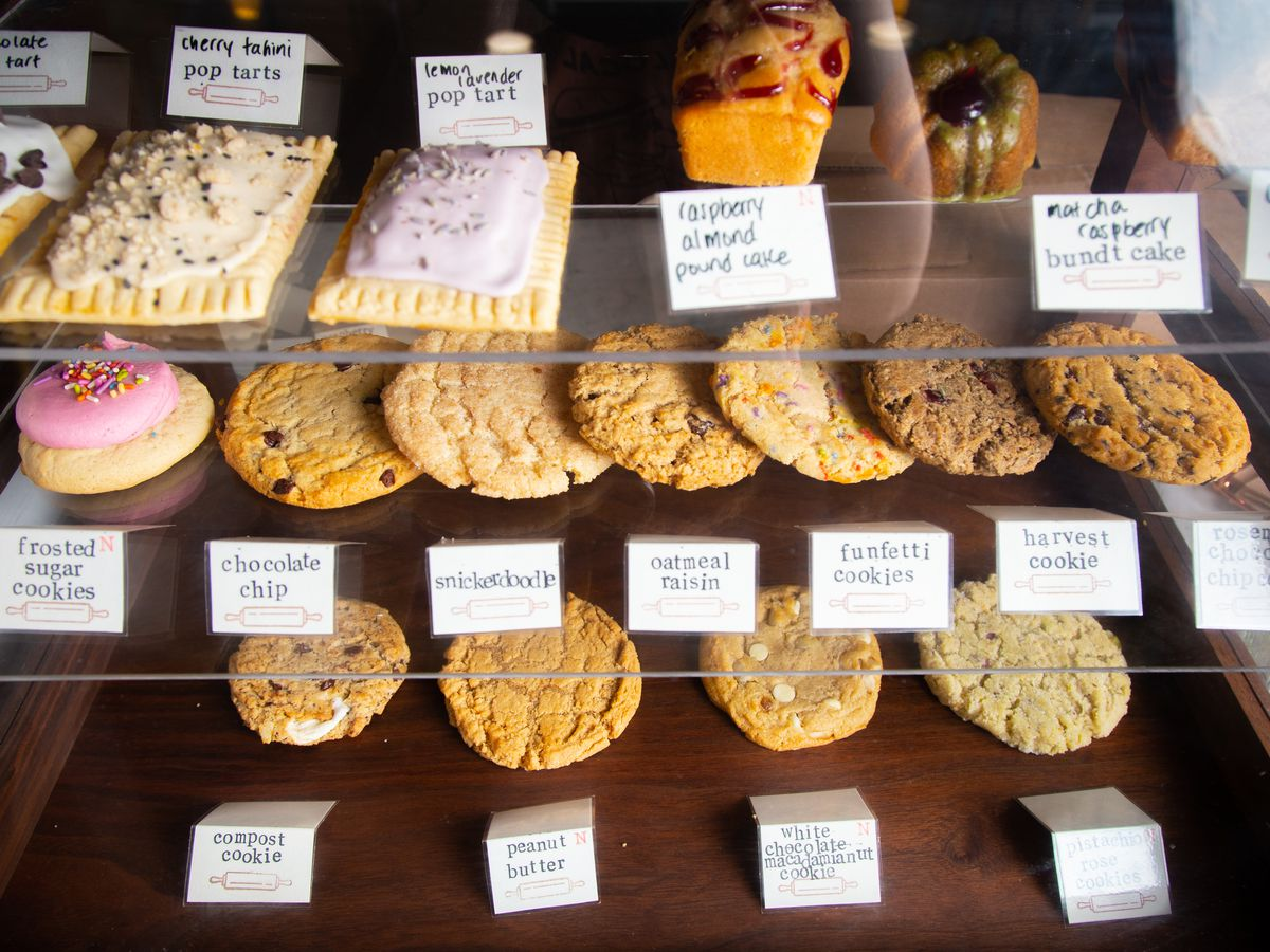 cookies and pop tarts in a glass pastry case at crust vegan bakery