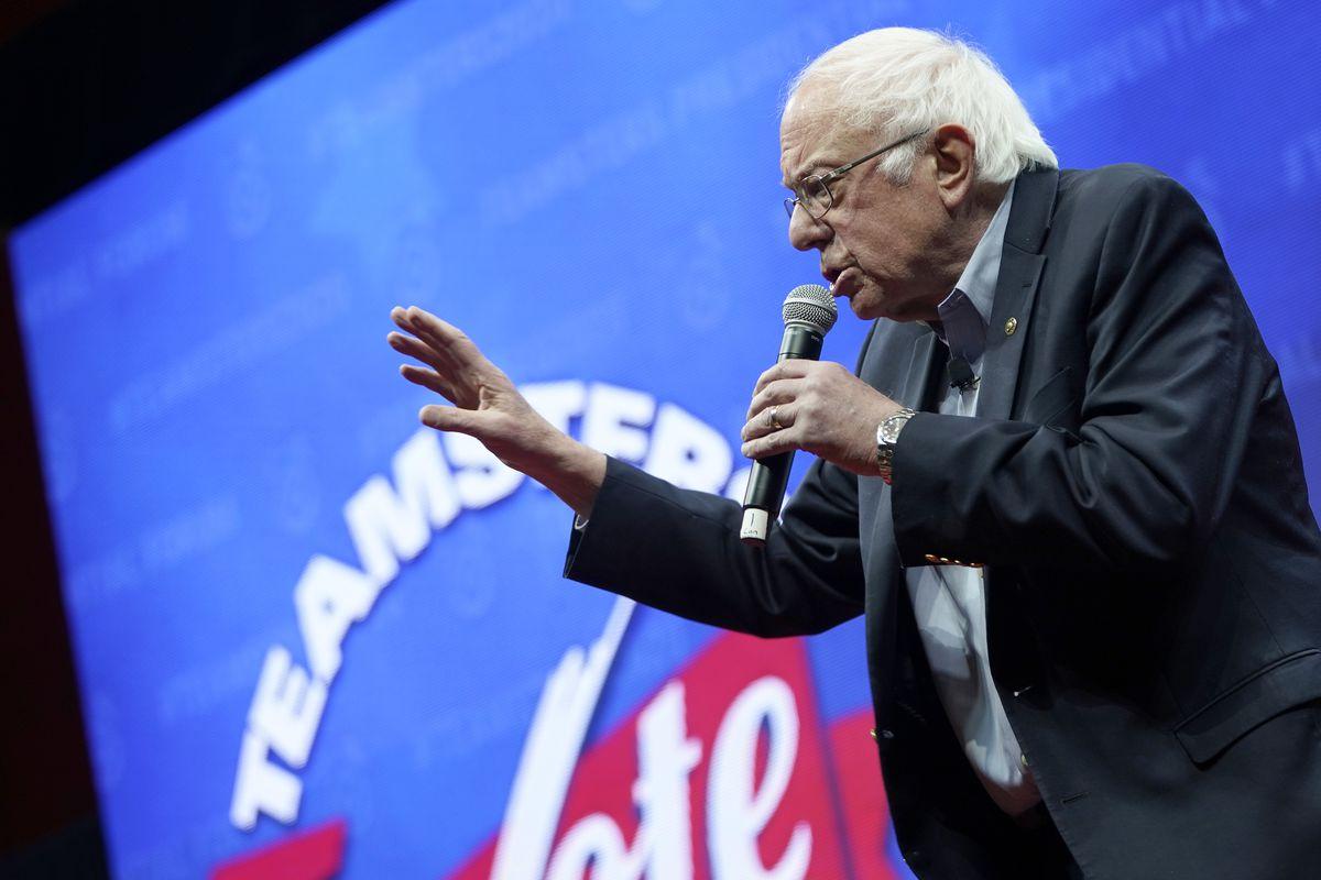 Bernie Sanders, in profile, speaking into a microphone.