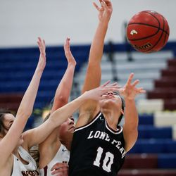 Lone Peak's Teuila Nawahine's (10) shot is blocked by the Herriman defense during a high school basketball game at Herriman High School in Herriman on Thursday, Dec. 3, 2020.