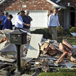 President Barack Obama walks past debris on the sidewalks as he tours the Bridgewood neighborhood in LaPlace, La., in the Saint John the Baptist Parish, with local officials to survey the ongoing response and recovery efforts to Hurricane Isaac, Monday, Sept. 3, 2012.