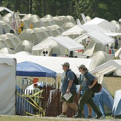 Boy Scouts leave their camp at the National Scout Jamboree at Fort AP Hill in Virginia Tuesday. Scouts from Utah are attending the event.