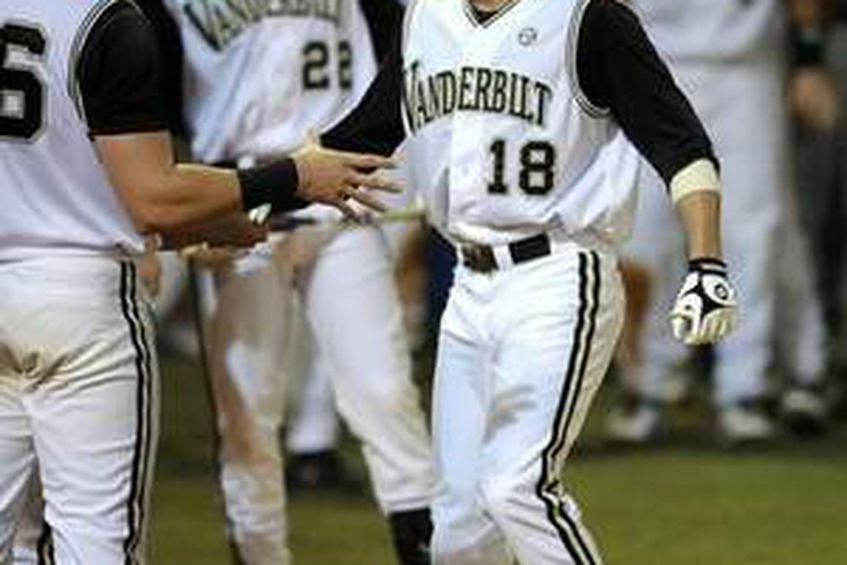 Mike Yastremski (18) crosses home plate after his three run home run in the fourth inning broke open the game, as Vanderbilt went on to beat Oregon St. 11-1 in the NCAA Super Regionals. <em>(Photo by George Walker IV / The Tennessean)</em>