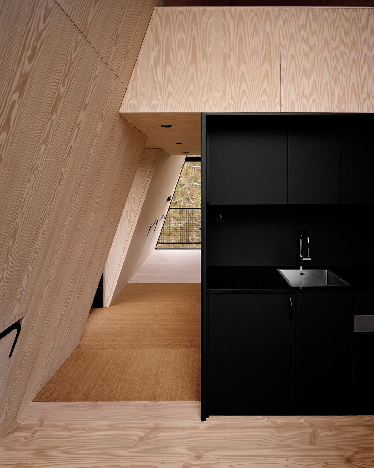Small kitchen with sink and black cabinets