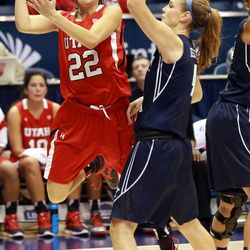 Utah's Danielle Rodriguez passes the ball around BYU's Kim Beeston during a women's basketball game at the Marriott Center in Provo on Saturday, Dec. 14, 2013. Utah won in double overtime 82-74.