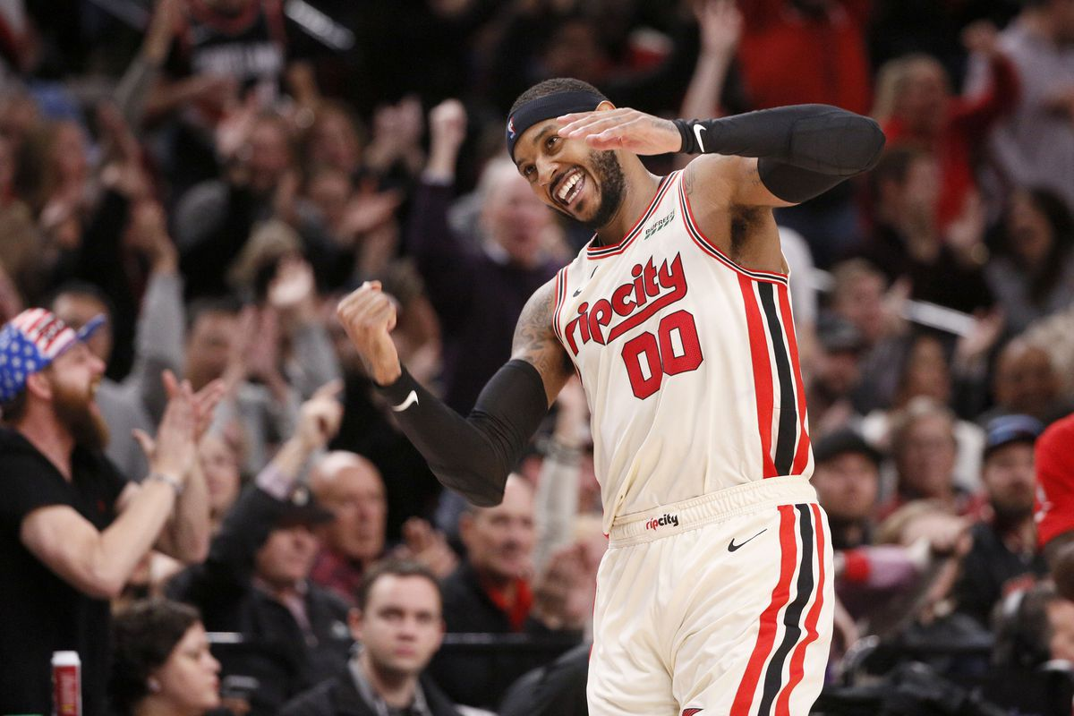 Portland Trail Blazers power forward Carmelo Anthony reacts after a three point basket against the Chicago Bulls during the second half at Moda Center.