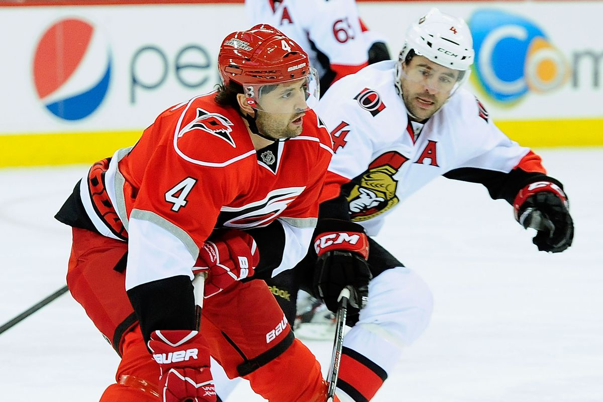 Jamie McBain is defended by Chris Phillips on February 1 at the PNC