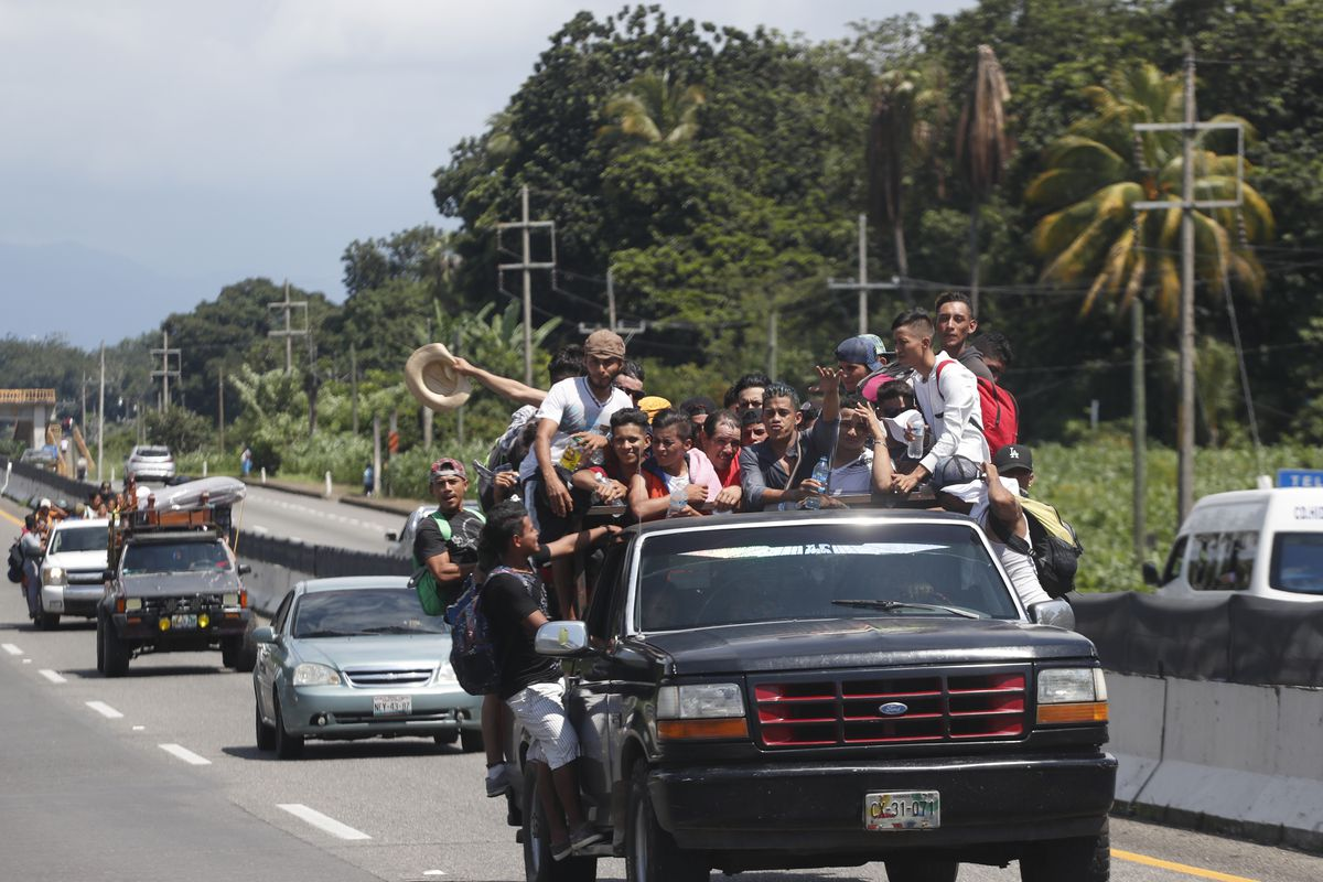 Central American migrants making their way to the U.S. in a large caravan fill the truck of a driver who offered them the free ride, as they arrive to Tapachula, Mexico, Sunday, Oct. 21, 2018. Despite Mexican efforts to stop them at the Guatemala-Mexico b