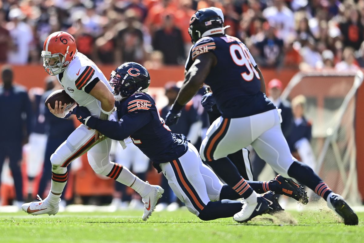 Bears linebacker Khalil Mack (52) sacks Browns quarterback Baker Mayfield in the first half Sunday. Mack had two sacks and gutted through the second half with a sprained foot in the Bears 26-6 loss at FirstEnergy Stadium.