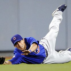 Chicago Cubs center fielder Sam Fuld makes a diving catch on a ball hit by Los Angeles Dodgers' Casey Blake.