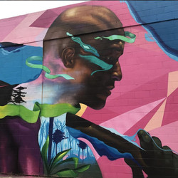 """One half of """"Equals, We,"""" completed by Max Sansing in 2017, is located at 51st Street and South Calumet Avenue in Bronzeville."""