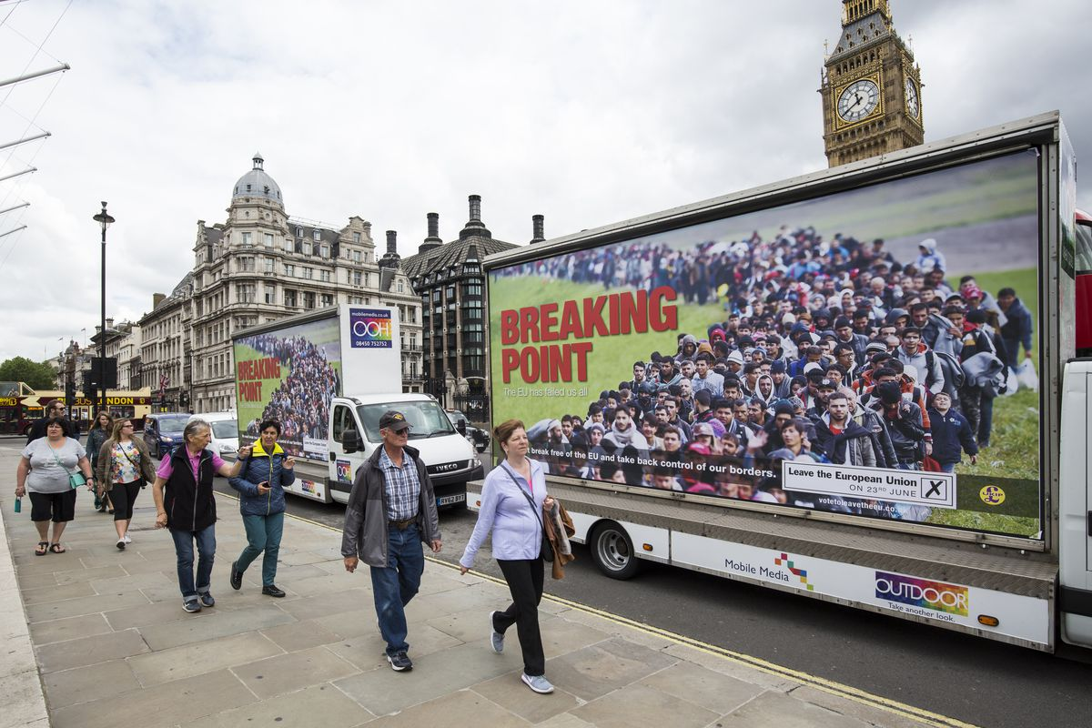 Vans displaying the United Kingdom Independence Party's new EU referendum campaign poster are driven around Parliament Square on June 16, 2016, in London, England.
