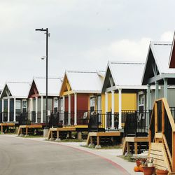 Colorful tiny homes are lined up at Community First! Village in Austin, Texas, on Tuesday, Oct. 20, 2020.