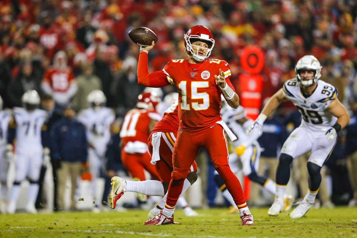 Quarterback Patrick Mahomes of the Kansas City Chiefs prepares to throw a pass against the Los Angeles Chargers at Arrowhead Stadium on December 13, 2018 in Kansas City, Missouri.