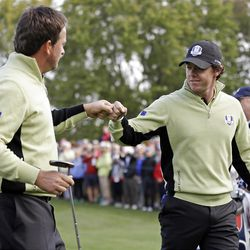 Europe's Graeme McDowell and Rory McIlroy celebrate during a foursomes match at the Ryder Cup PGA golf tournament Friday, Sept. 28, 2012, at the Medinah Country Club in Medinah, Ill. (AP Photo/David J. Phillip)