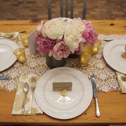"""""""Consider repurposing some fabric into a table runner. Here, we used lace left over from another project."""""""