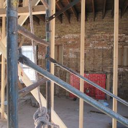 1:11 p.m. Interior view of the groundkeeper's cottage, from the northwest corner stairwell -