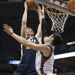 Milwaukee Bucks' Ersan Ilyasova, right, tries to stop Utah Jazz Gordon Hayward during the second half of an NBA basketball game Monday, March 3, 2014, in Milwaukee. (AP Photo/Tom Lynn)