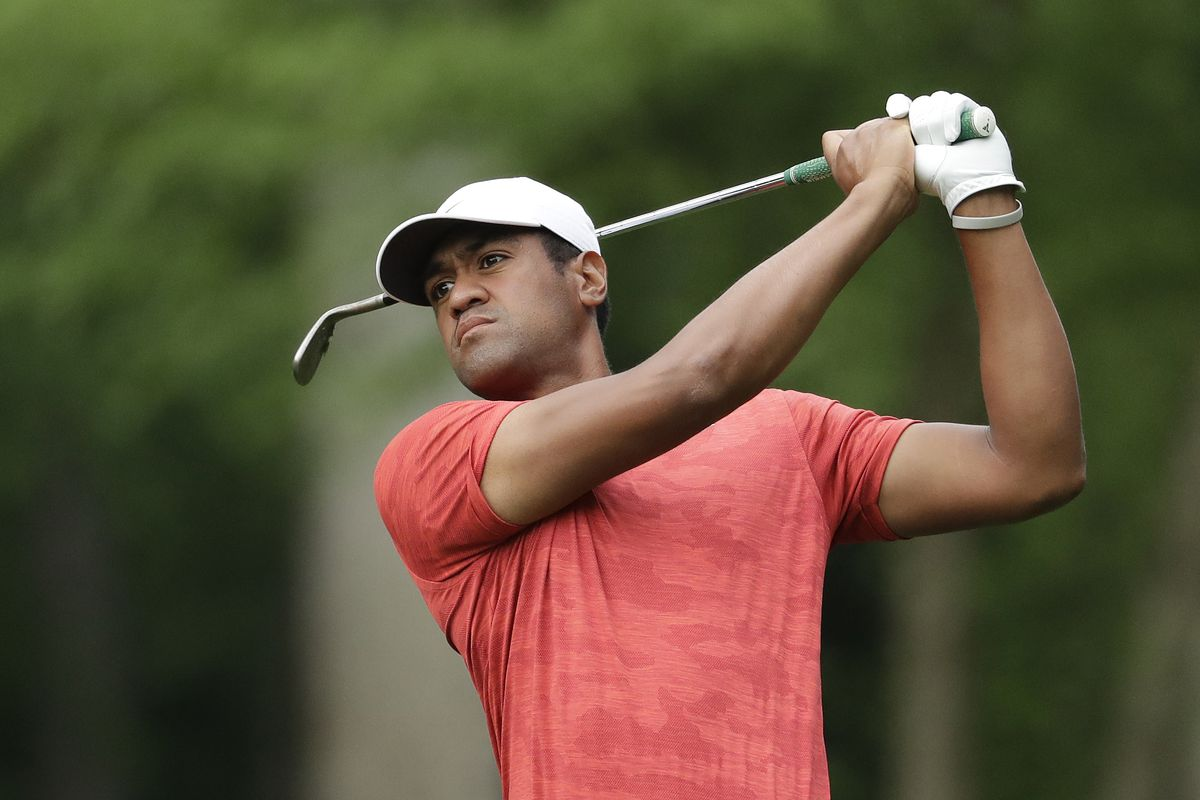 Tony Finau watches his approach shot on the 12th hole during the second round of the Wells Fargo Championship golf tournament at Quail Hollow Club in Charlotte, N.C., Friday, May 3, 2019.