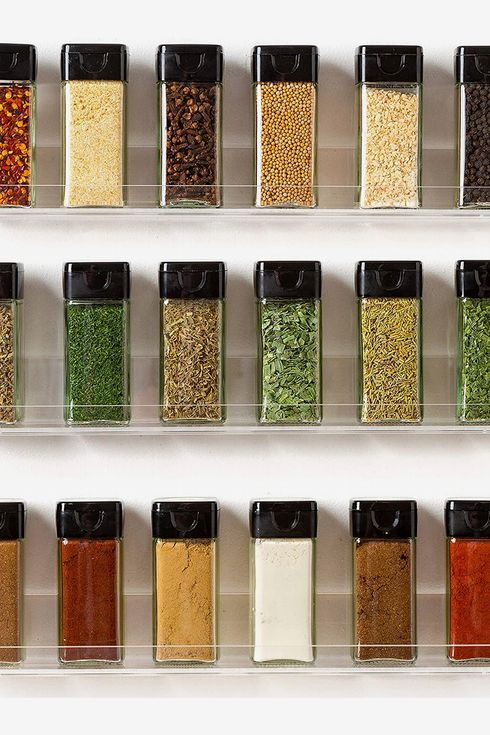 Assorted spices in an acrylic wall mounted organizer