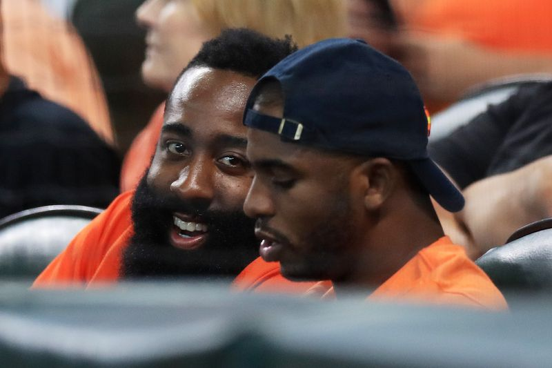 James Harden and Chris Paul in the stands at Minute Maid Park