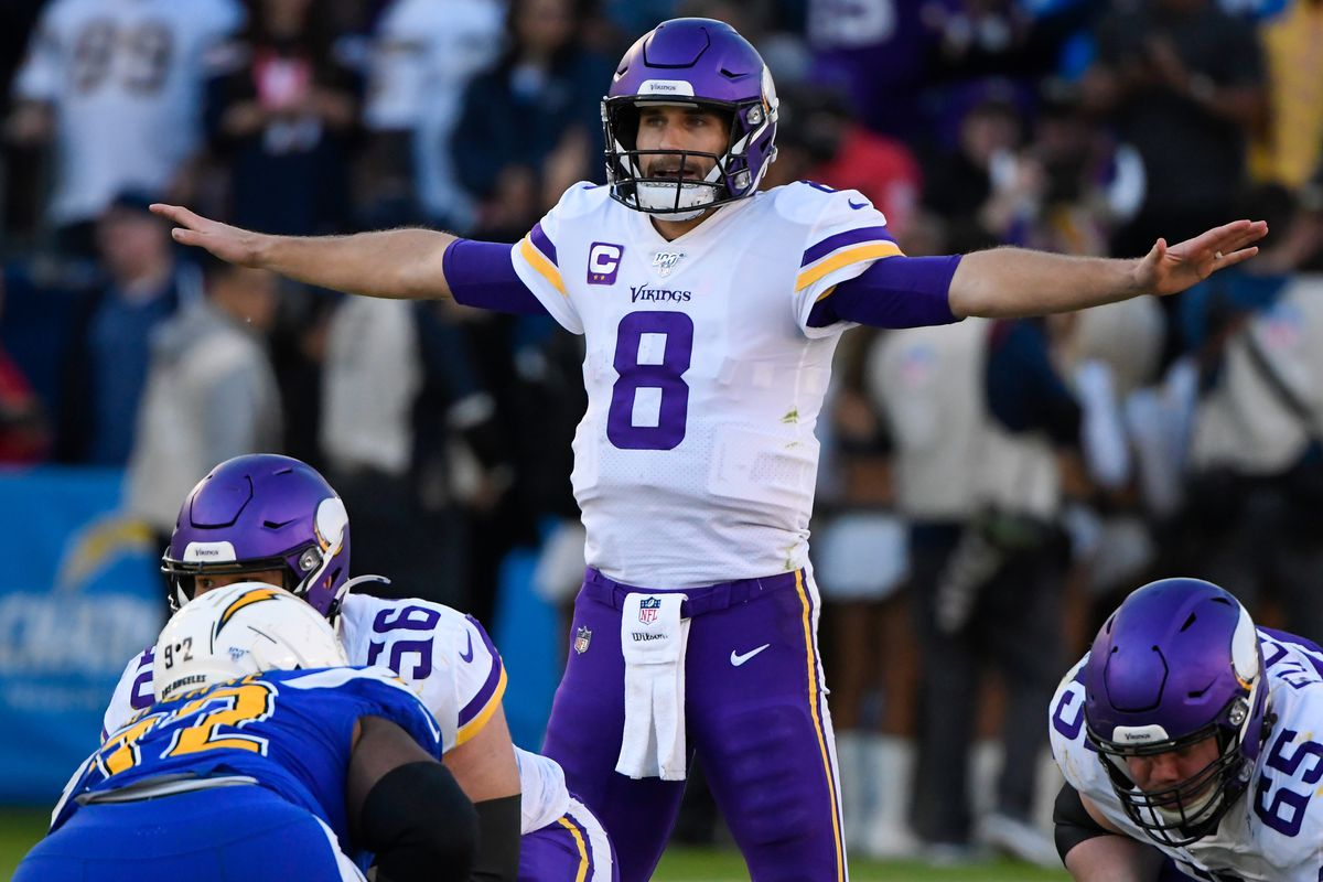 Minnesota Vikings quarterback Kirk Cousins calls a play during the fourth quarter against the Los Angeles Chargers at Dignity Health Sports Park.