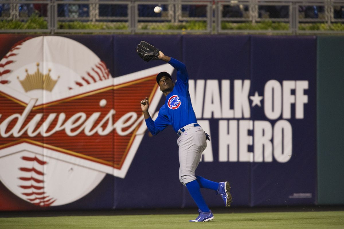 Philadelphia, PA, USA; Chicago Cubs left fielder Alfonso Soriano makes a catch against the Philadelphia Phillies at Citizens Bank Park. The Cubs defeated the Phillies 5-1. Credit: Howard Smith-US PRESSWIRE