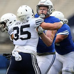 Matt Bushman and Nate Sampson compete during the Blue-White game at LaVell Edwards Stadium in Provo on Saturday, April 7, 2018.