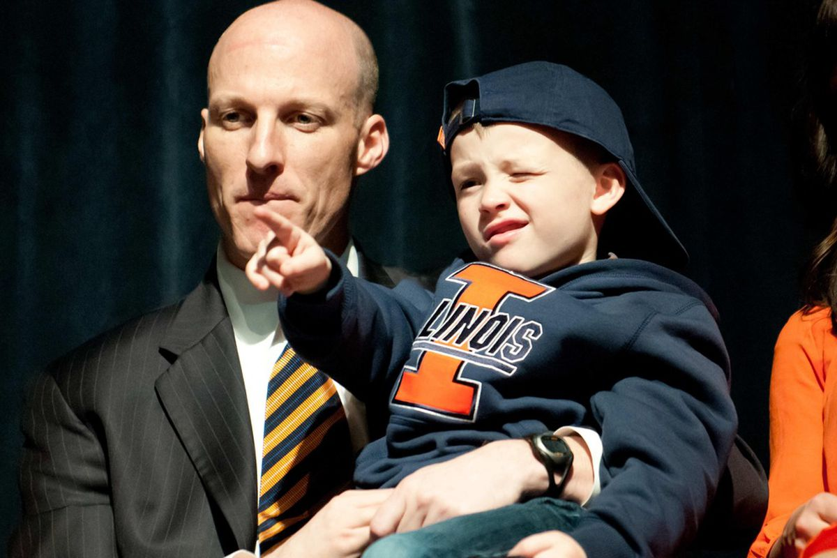 Mar 29, 2012; Champaign, IL, USA; Illinois Fighting Illini head coach John Groce (left) holds his son Conner Groce at a press conference at Assembly Hall.  Mandatory Credit: Bradley Leeb-US PRESSWIRE