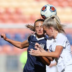 Bonneville's Sadie Beardall, left, and Skyline's Tala Goddard try to head the ball as they play in 5A girls soccer state semifinal action at Rio Tinto Stadium in Sandy, Utah, on Tuesday, Oct. 20, 2020. Bonneville won 2-0.